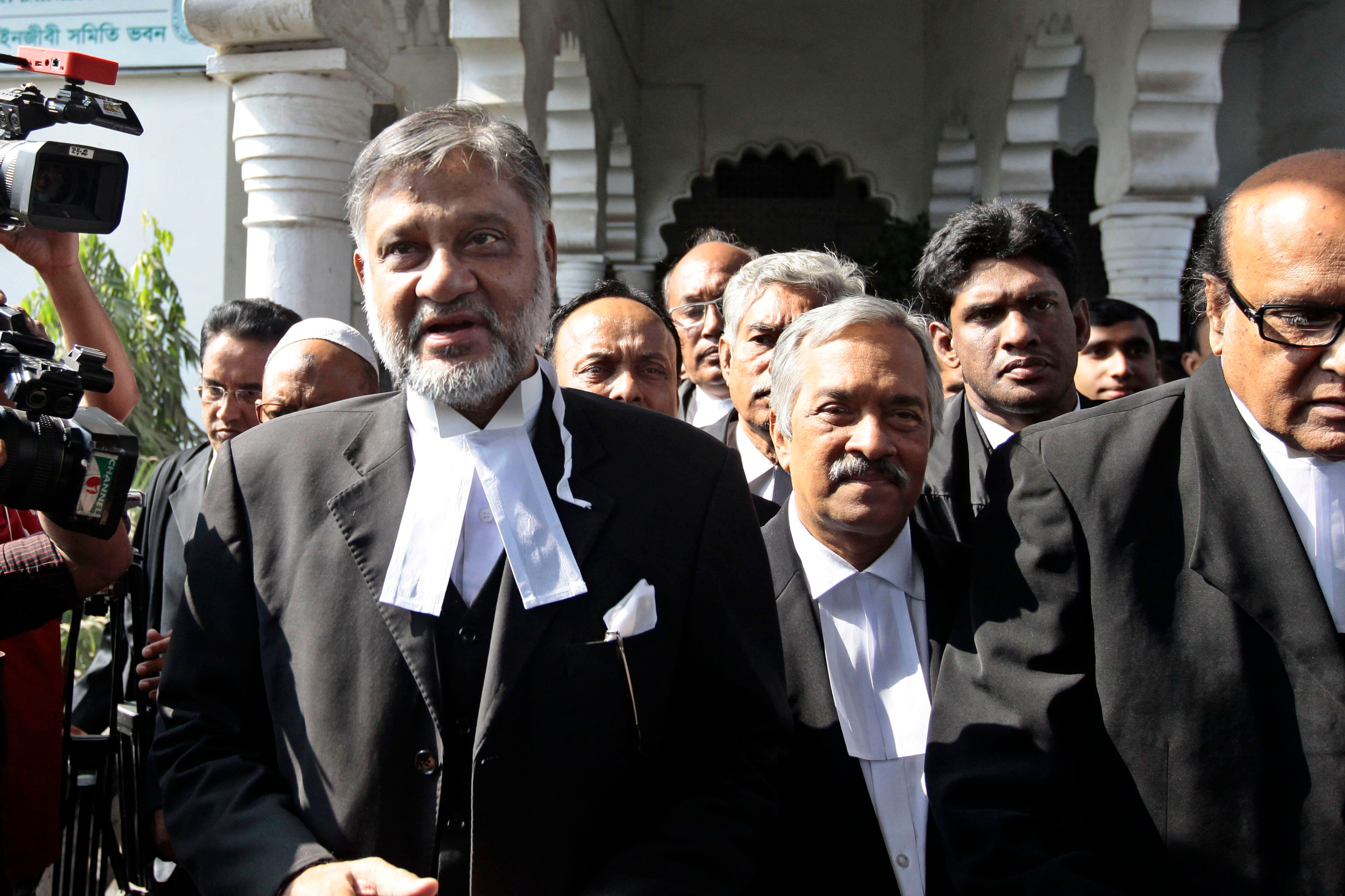 Abdur Razzak, left, lawyer of Islamist opposition leader Abdul Quader Mollah, talks to the media outside a court in Dhaka, Bangladesh. Mollah, convicted of war crimes during the nation`s war of independence against Pakistan in 1971, was due to be executed at 00:01 Wednesday, but lawyers went to the home of Judge Syed Mahmud Hossain and secured a postponement.