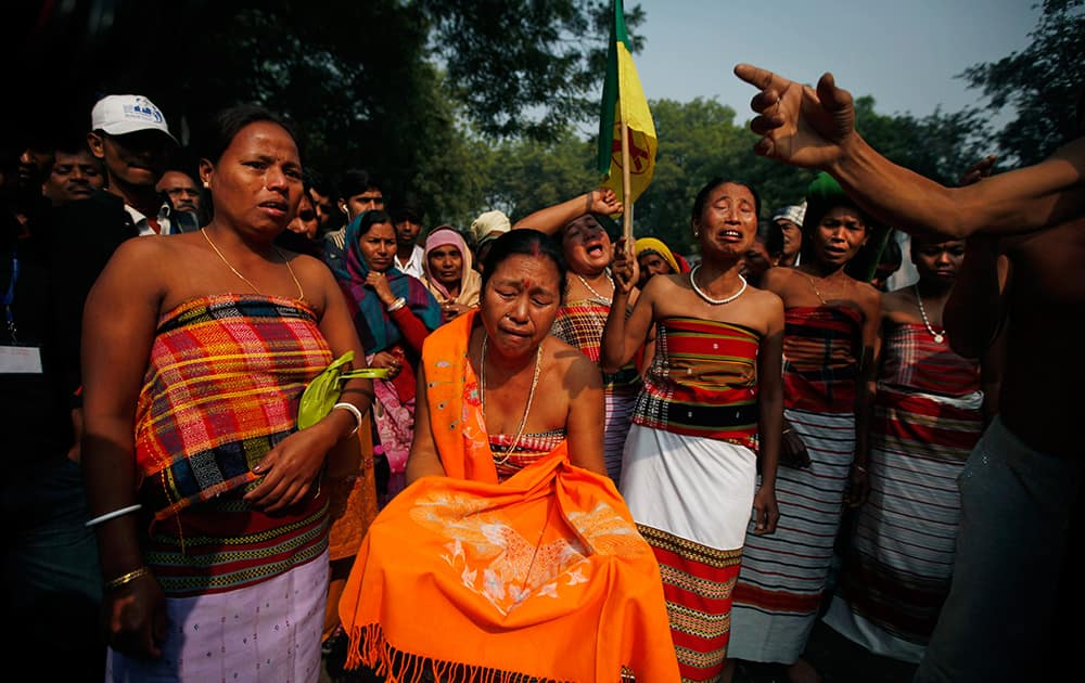 Indigenous people from north eastern Tripura state cry as they demand the creation of a new state called