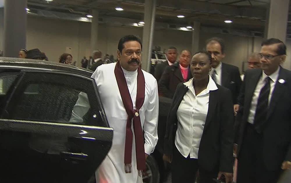 Sri Lankan President Mahinda Rajapaksa arrives at the FNB Stadium in Soweto, South Africa, ahead of a memorial service for former South African President Nelson Mandela.