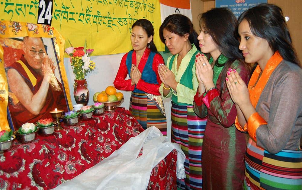 Tibetan refugees offering prayers for the long life of Dalai Lama on the 24th anniversary of Dalai Lama's Nobel Peace Prize award in Bhopal.