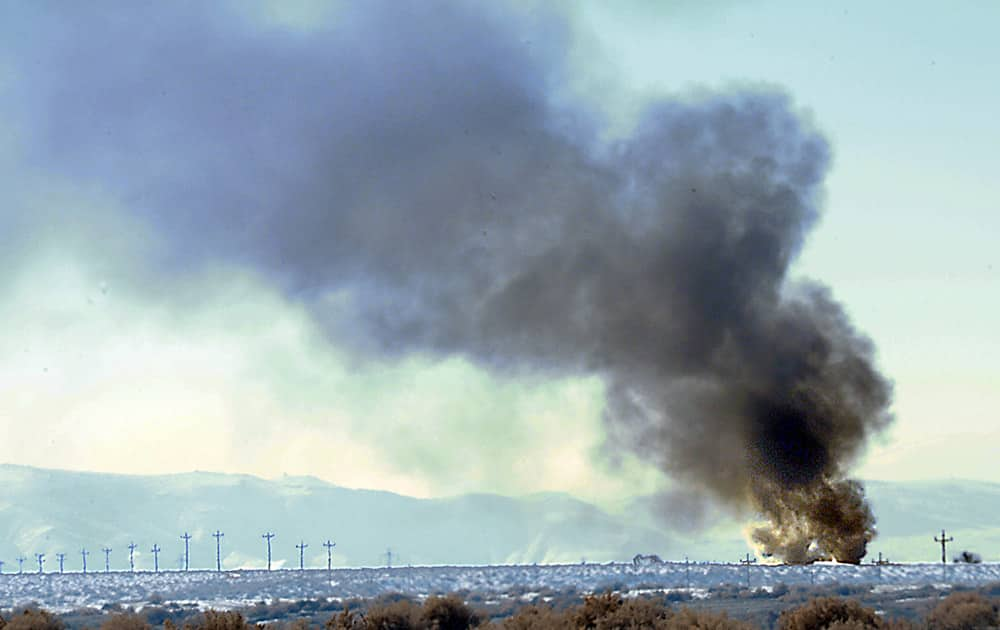 Smoke from the Bango Refining oil plant explosion can be seen along U.S. 50 alternate between Fernley and Fallon. Monday`s fire critically injured a 24-year-old refinery worker.