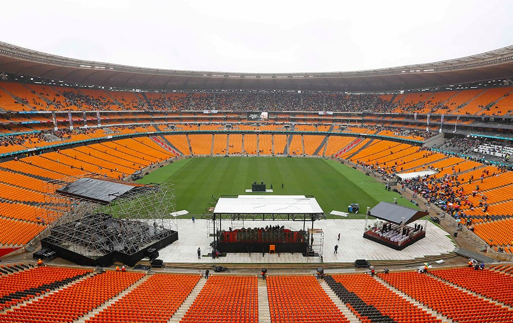 Early arrivals take their seats ahead of the memorial service for former South African president Nelson Mandela at the FNB Stadium in Soweto, near Johannesburg, South Africa.