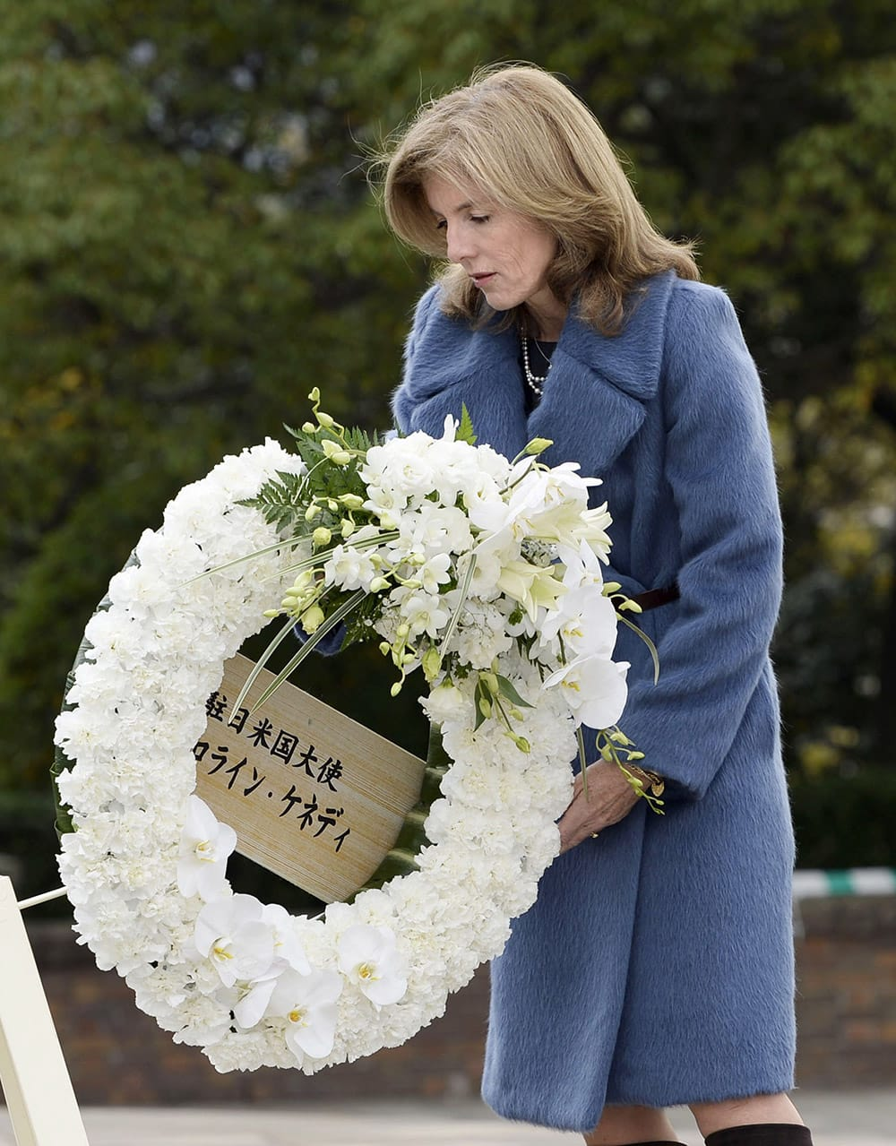 Caroline Kennedy, U.S. ambassador to Japan, offers a wreath in front of the Statue of Peace at Nagasaki Peace Park in Nagasaki, southern Japan.