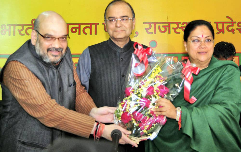 Rajasthan BJP President Vasundhara Raje being greeted by party`s Senior leader Arun Jaitley and Amit Shah during meeting at Party office for electing new Chief Minister of Rajasthan in Jaipur.