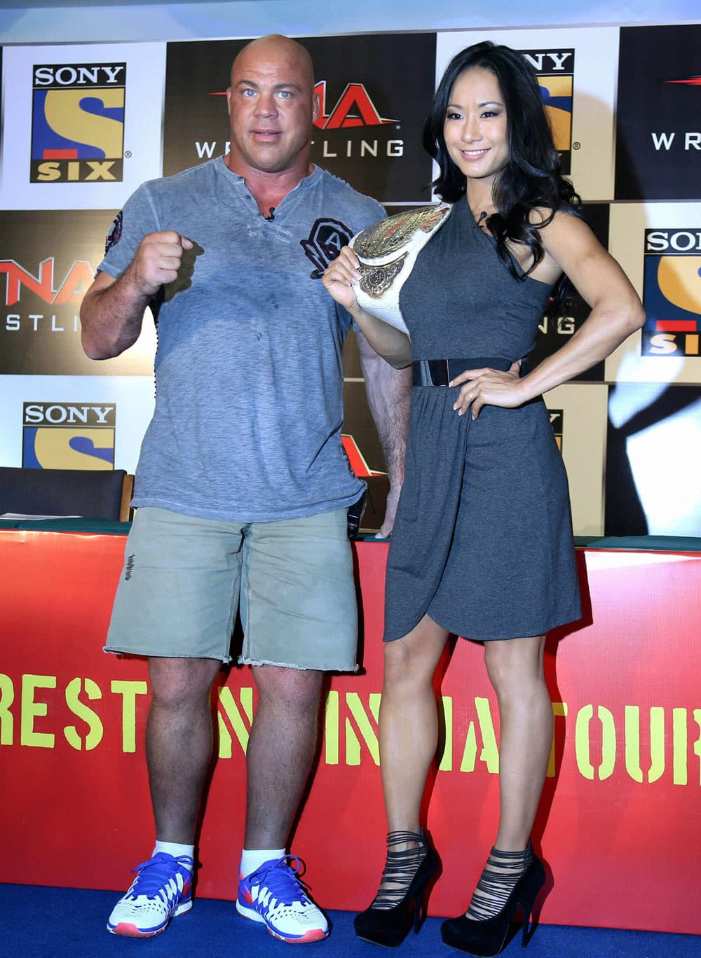 International wrestler and olympic gold medalist Kurt Angle alongwith woman wrestler Gail Kim during a promotional event in Mumbai.