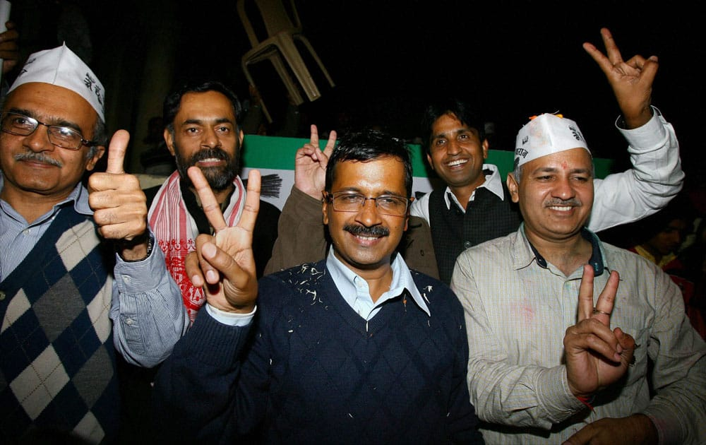 Aam Aadmi Party convener Arvind Kejriwal shows victory sign with Manish Sishodia, Prashant Bhushan, Yogendra Yadav and Kumar Vishwas during a press conference after party`s excellent show in Delhi Assembly elections, in New Delhi.