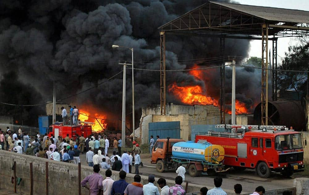 Fire men dousing a fire at a chemical factory at Jeedimetla, Hyderabad.
