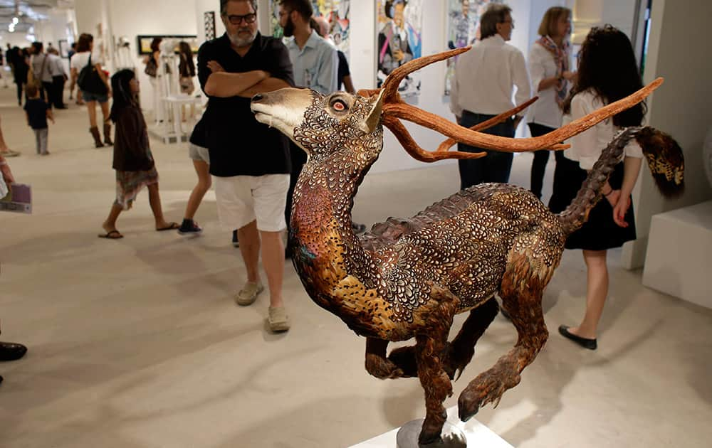 A sculpture made with real animal feathers titled