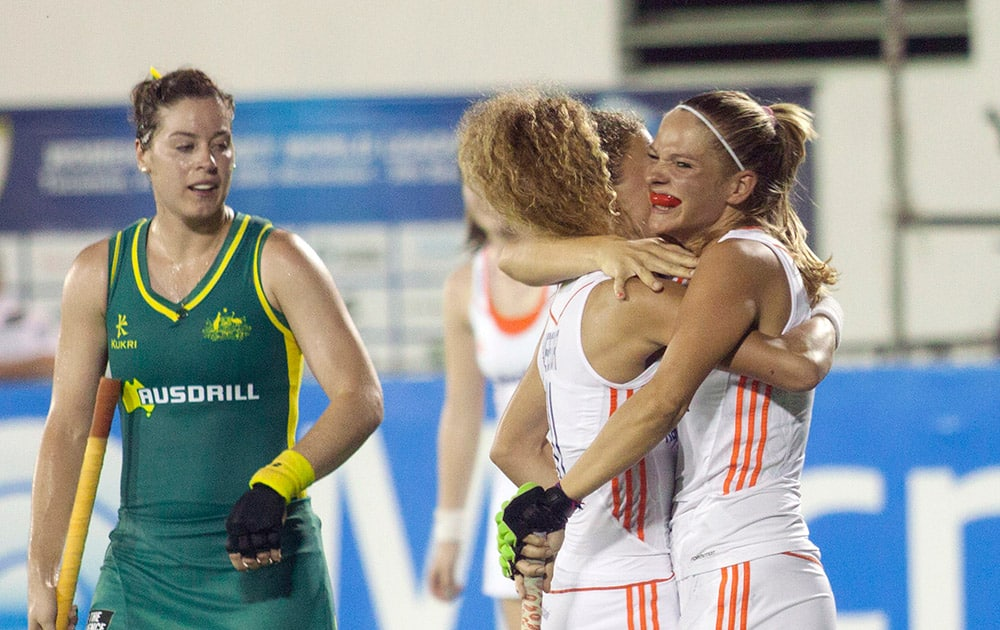Netherlands` Xan de Waars, right, celebrates with teammates as Australia`s Carrie McMahon, left, looks on during the women`s field hockey World League final game, in San Miguel de Tucuman, Argentina.