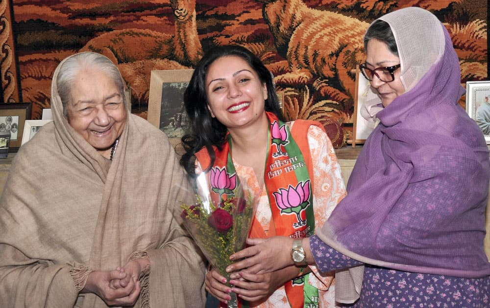 BJP candidate Princess Siddhi Kumari with her mother Padma Devi and grandmother Rajmata Sushila Devi after her victory in Assembly elections, in Bikaner.