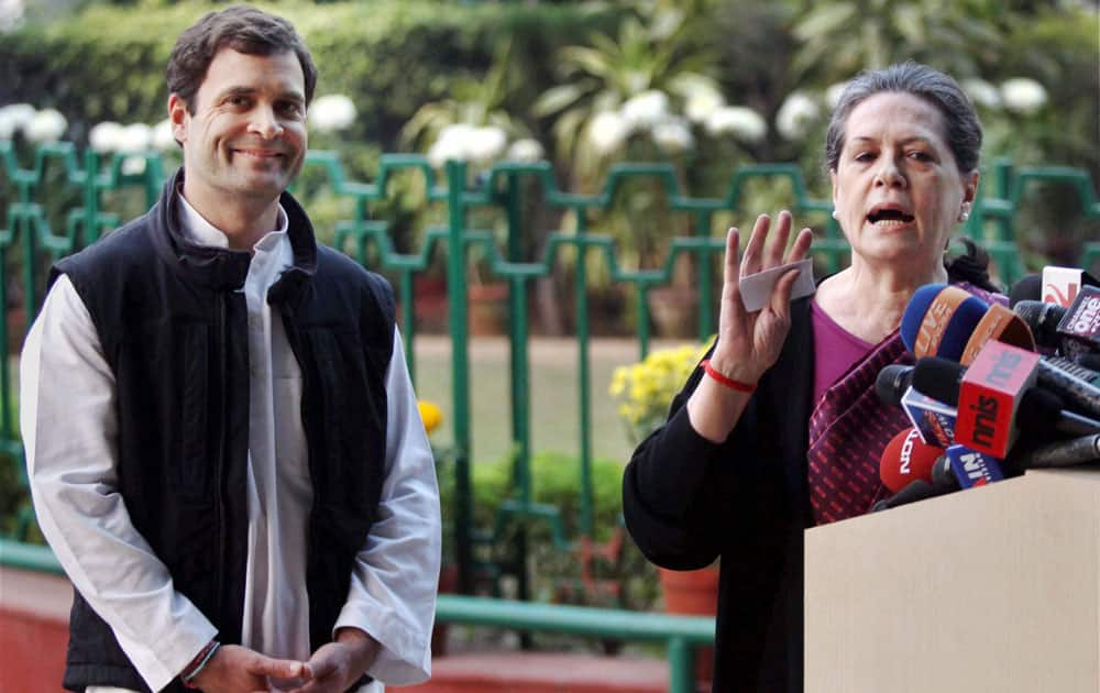 Congress President Sonia Gandhi with Vice President Rahul Gandhi addresses the media at AICC in New Delhi.
