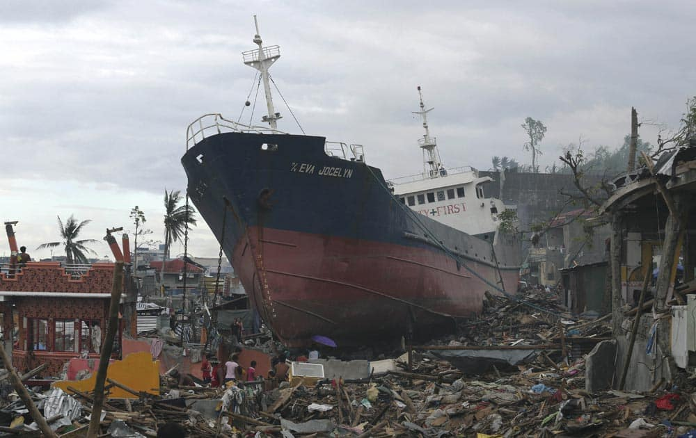 A ship, which was washed ashore during Typhoon Haiyan, lies among the debris of destroyed homes in Tacloban, central Philippines.