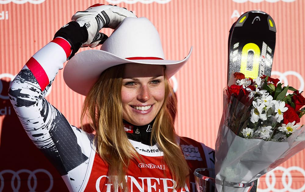 Austria`s Anna Fenninger celebrates her third place finish in the second women`s World Cup downhill skiing race at Lake Louise, Alberta.