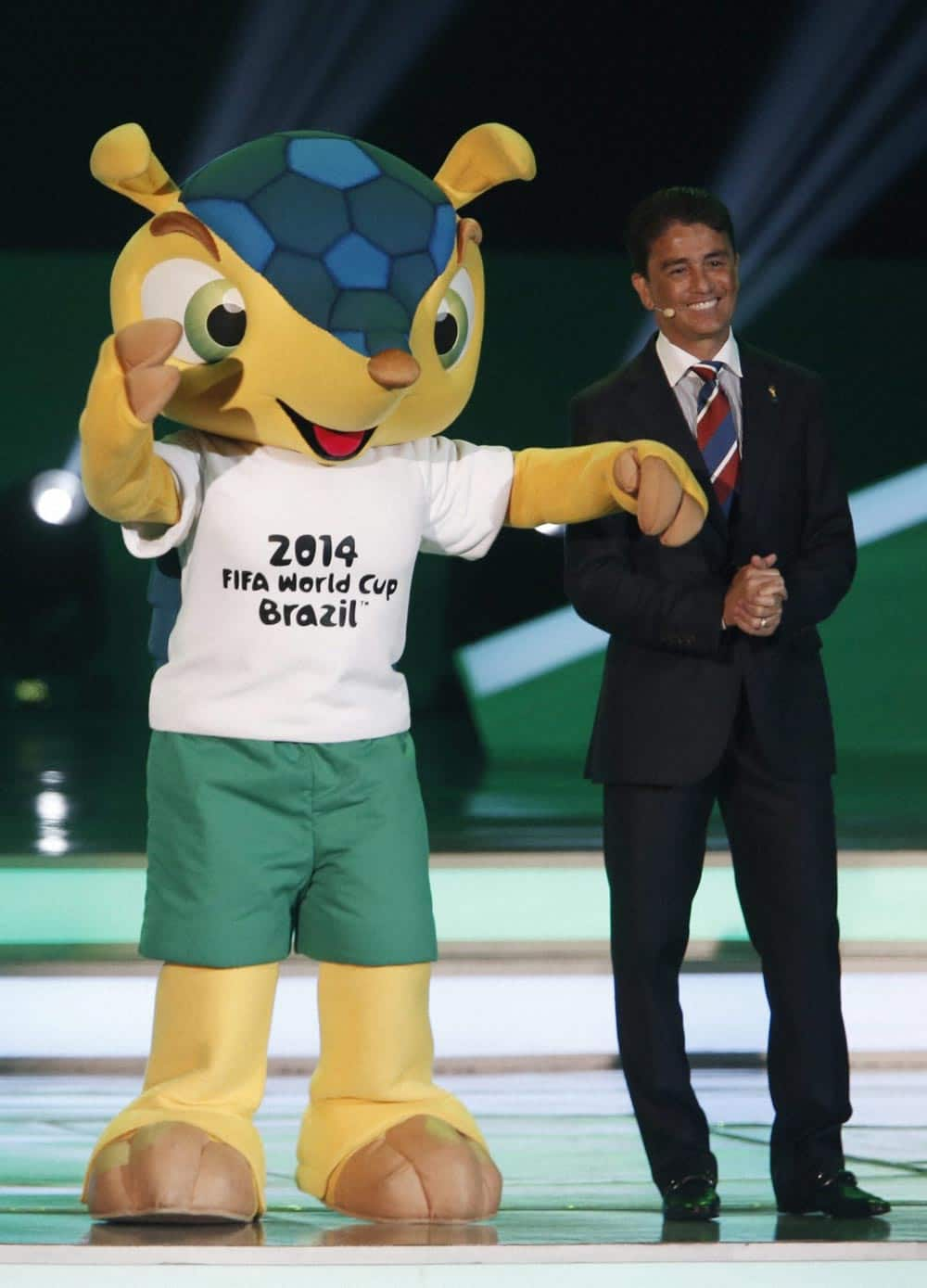 Former Brazilian soccer player Bebeto presents Mascot Fuleco during the draw ceremony for the 2014 soccer World Cup in Costa do Sauipe near Salvador, Brazil.
