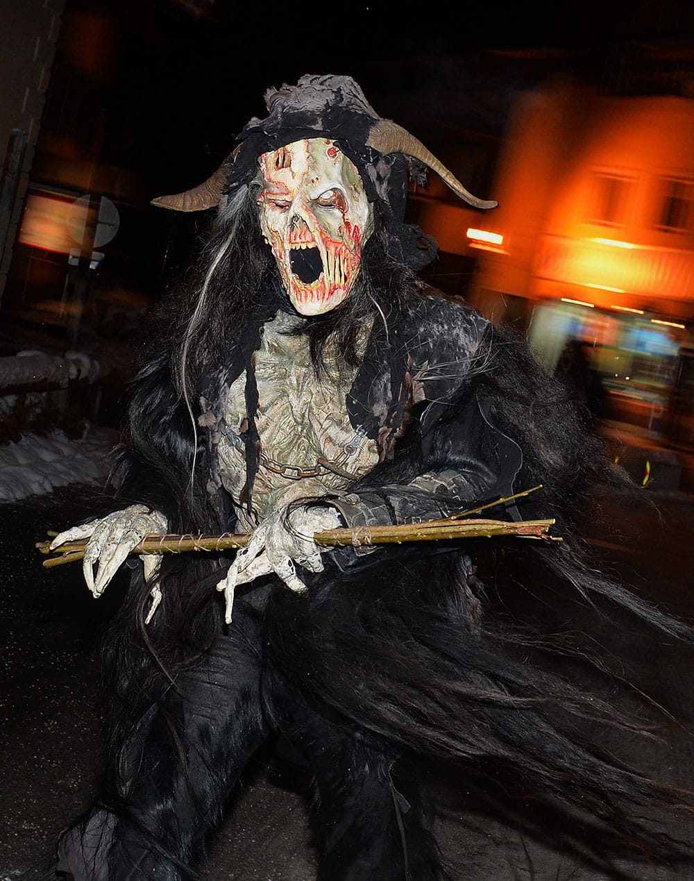 A MAN DRESSED AS A KRAMPUS, THE COMPANION OF ST. NICHOLAS AND ONE OF AUSTRIA`S UNIQUE ADVENT TRADITIONS, MAKES HIS WAY DURING A TRADITIONAL KRAMPUS PROCESSION IN LOFER, AUSTRIAN PROVINCE OF SALZBURG.