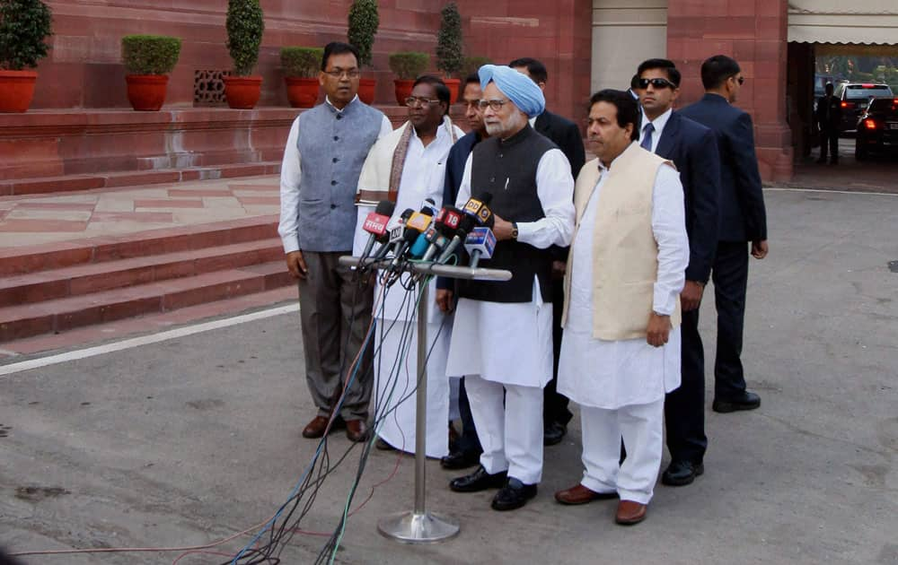Prime Minister Manmohan Singh, flanked by Parliamentary Affairs Minister Kamal Nath and Ministers of State V Narayanasamy, Paban Singh Ghatowar and Rajiv Shukla, arrives to address the media on the first day of the Winter Session in New Delhi.