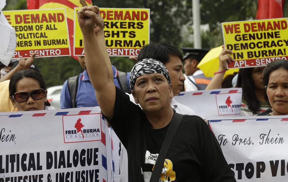 Protesters picket the Department of Foreign Affairs to coincide with the state visit of Myanmar President Thein Sein in Manila, Philippines.