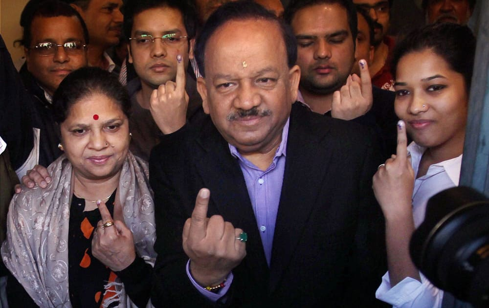 BJP`s CM candidate Harsh Vardhan with family members after casting their votes for Delhi Assembly elections, at a polling station in East Delhi.