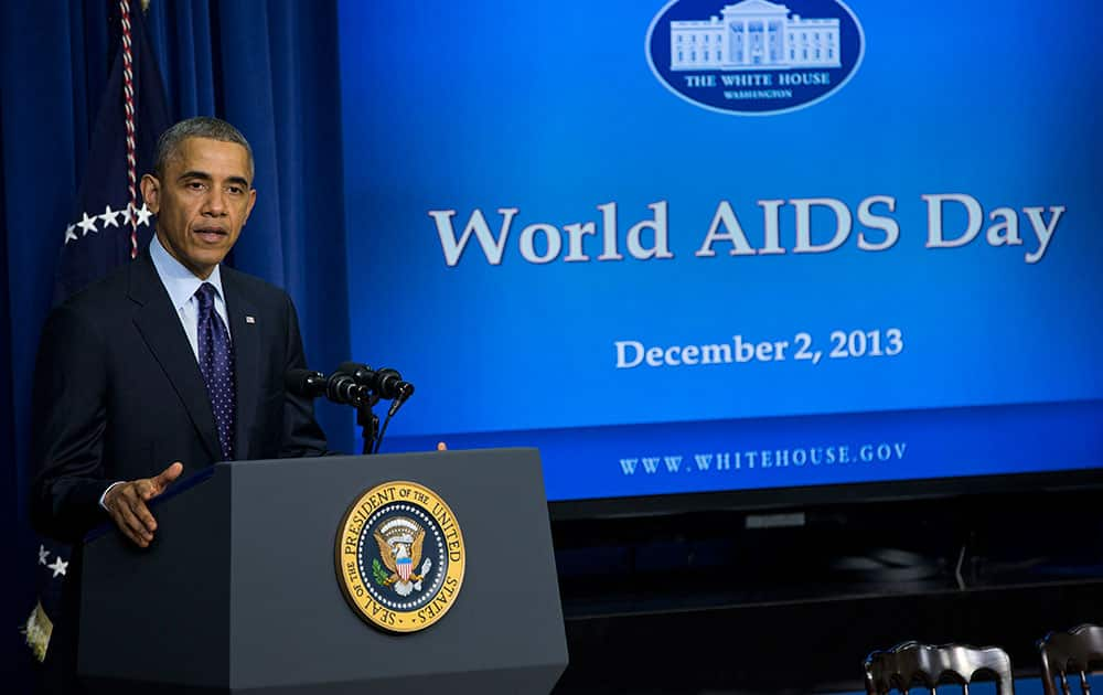 President Barack Obama gestures while speaking at a world AIDS Day event, in the South Court Auditorium on the White House complex in Washington.