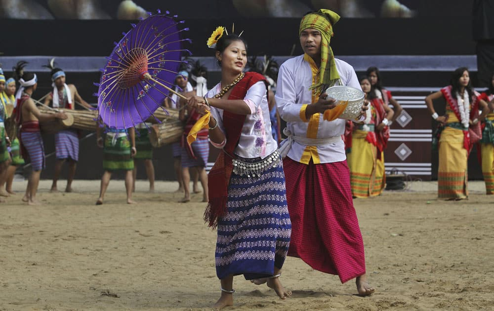 Tribal dancers from Tripura in traditional attire perform a dance during the Hornbill festival at Kisama village on the outskirts of Kohima, Nagaland.