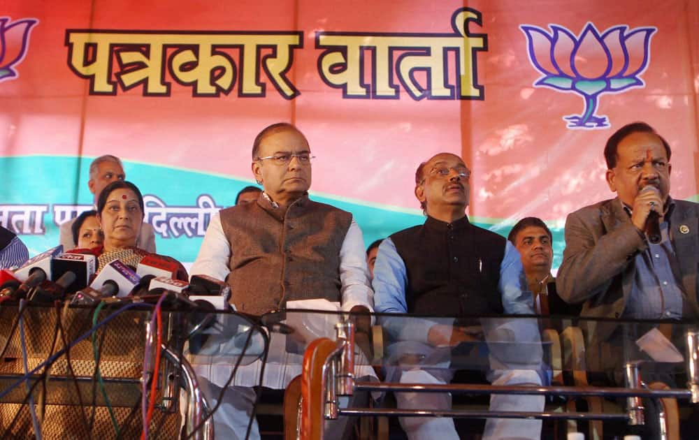 Senior BJP leaders Sushma Swaraj, V K Malhotra, Arun Jaitley and Delhi BJP president Vijay Goel look on as BJP CM candidate Harsh Vardhan addressing a press conference in New Delhi.