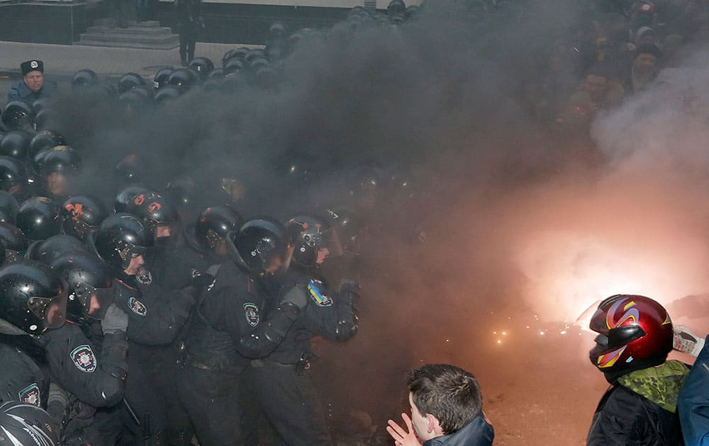 Smoke goes up as protesters clash with police outside the presidential office in Kiev, Ukraine.