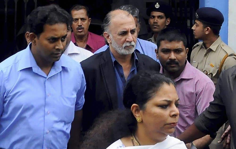 Tarun Tejpal is escorted after being produced at the Sessions Court in a sexual assault case in Panaji.