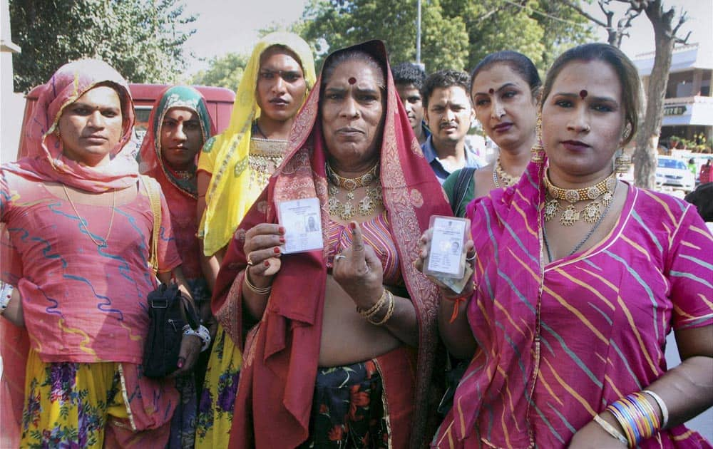 Eunuchs showing their voter id cards for Rajasthan assembly elections at a polling booth in Jodhpur.