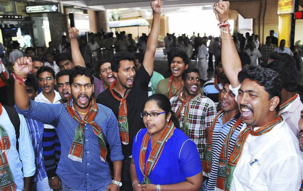 Activists of the youth wing of Bharatiya Janata Party shout slogans against Tarun Tejpal, editor of Tehelka magazine, ahead of his arrival at the airport in Panaji.