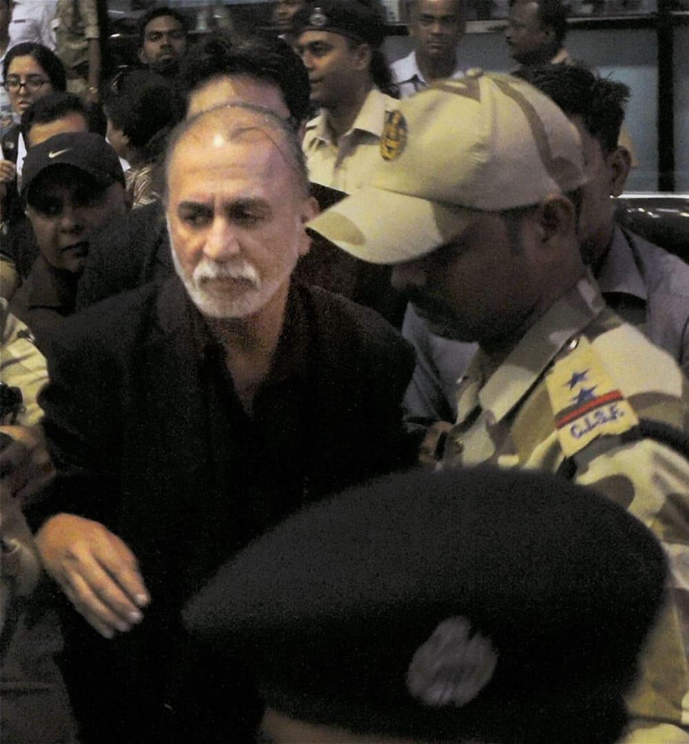 Tehelka editor-in-chief Tarun Tejpal is escorted on his arrival in Panaji, Goa.