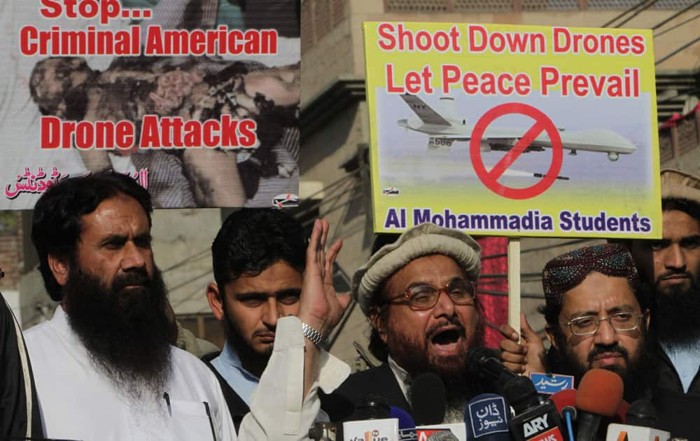 Hafiz Saeed, center, head of Pakistani religious group Jamaat-ud-Dawa addresses an anti-American rally in Lahore.