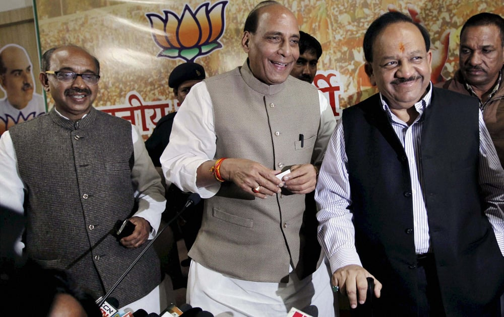 BJP president Rajnath Singh with party`s CM candidate for Delhi Assembly polls Harsh Vardhan and Delhi unit President Vijay Goel at a press conference at state party office in New Delhi.