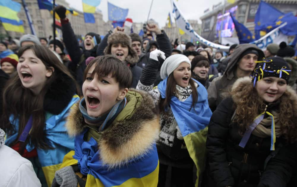 Ukrainian students shout slogans during a demonstration to support European Union integration at Independence Square in Kiev, Ukraine.