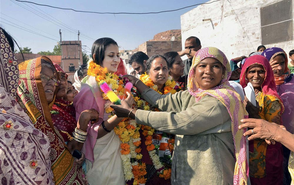 Rajasthan Chief Minister Ashok Gehlot`s wife Sunita Gehlot (2nd R) and daughter-in-law Himanshi campaign in Sardarpura Assembly in Jodhpur.