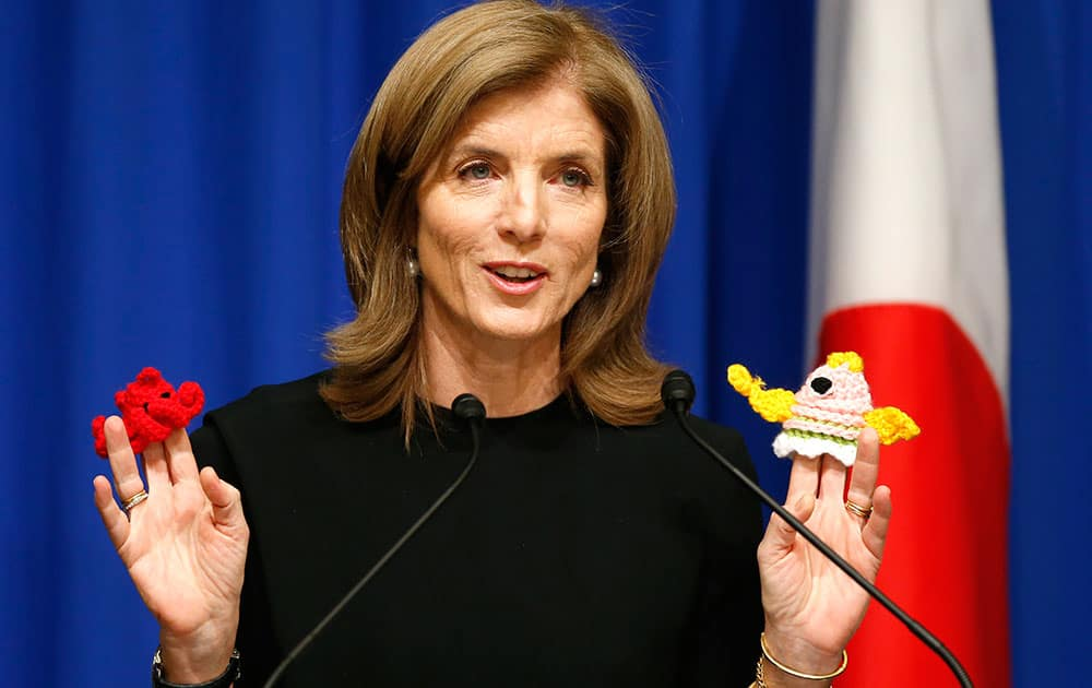 US Ambassador to Japan Caroline Kennedy, holds knitted pot scrubbers that tsunami survivors in Minamisanriku made at temporary housing facility, during a welcome luncheon hosted by the America-Japan Society and the American Chamber of Commerce in Japan, in Tokyo, Japan