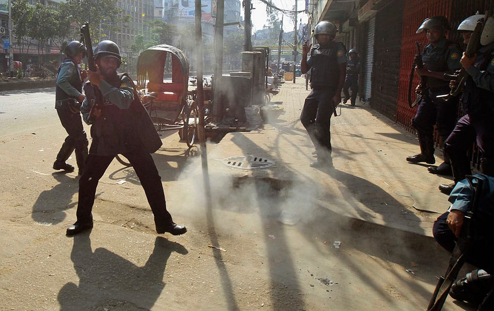 A homemade bomb explodes in front of Bangladeshi policemen during a nationwide strike in Dhaka, Bangladesh.