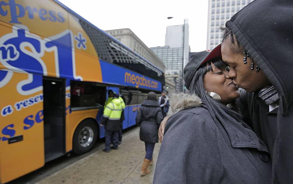Shay Owens kisses her boyfriend Bryan Jordan before boarding a Megabus for a trip to Atlanta, in Chicago.