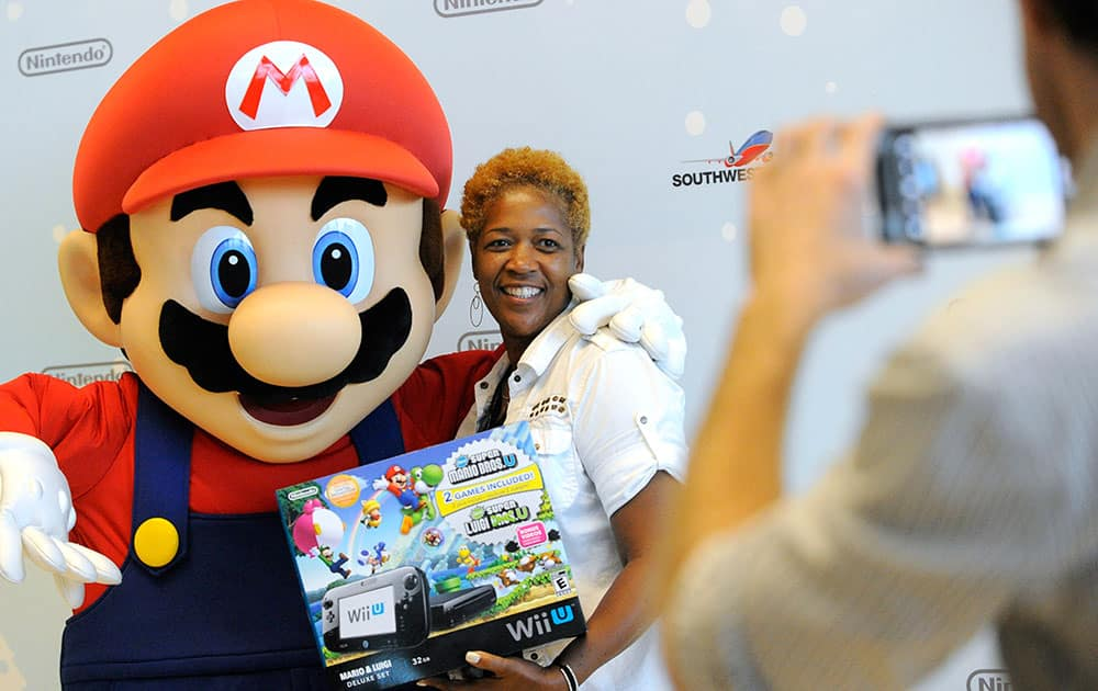 Dorcas H. from La Place, LA, is one of the first passengers to thank Mario for giving away free Wii U systems on a Southwest Airlines flight from New Orleans to Dallas Love Field in Dallas, TX in Dallas.