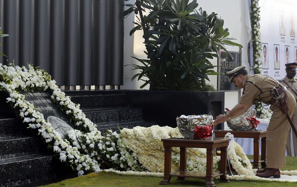 A police officer offers tribute at the memorial for police and uniformed personnel who lost their lives in the 2008 Mumbai terror attacks during the 5th anniversary of the attack in Mumbai.