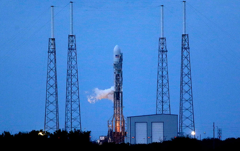 A Falcon 9 SpaceX rocket sits on Launch Complex 40 just before the launch window opened at the Cape Canaveral Air Force Station in Cape Canaveral, Fla.