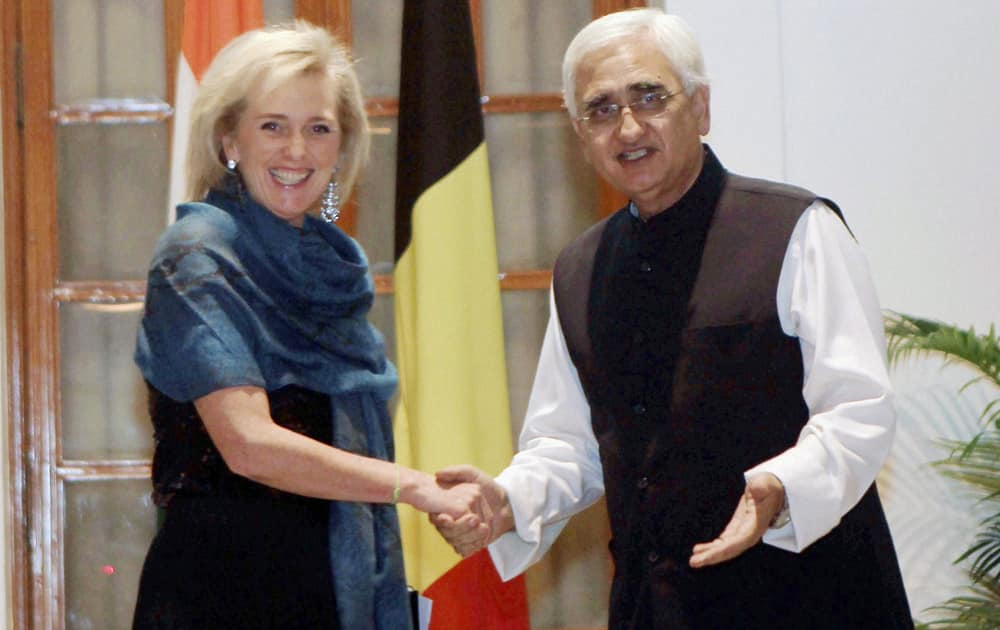 Minister of External Affairs Salman Khurshid shakes hands with Princess Astrid of Belgium, at a meeting in New Delhi.