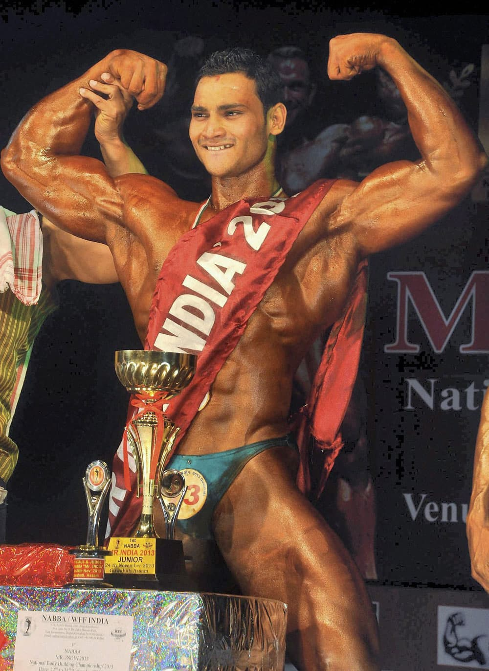 Bikash Kumar Sahoo of Odisha poses after winning the 1st National Body Building Championship 2013 in Guwhati.