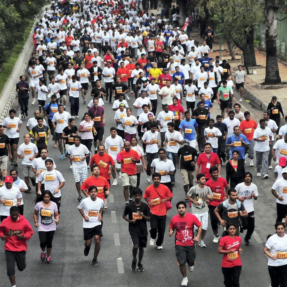 Runners participate in 11th Hyderabad 10k run in Hyderabad.