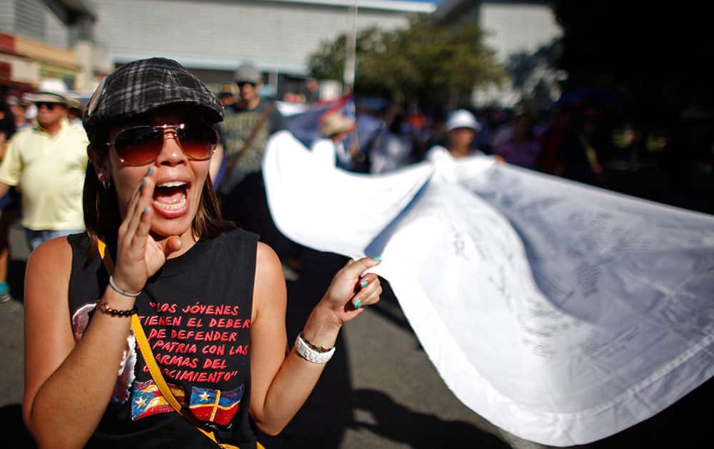 A woman shouts slogans during a march demanding the release of former militant Oscar Lopez in San Juan, Puerto Rico.