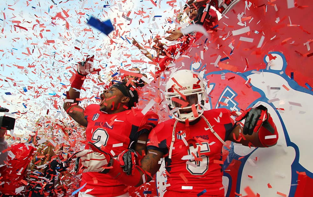 Fresno State`s Jamal Ellis and Dalen Jones celebrate a victory over New Mexico after their NCAA college football game in Fresno, Calif.