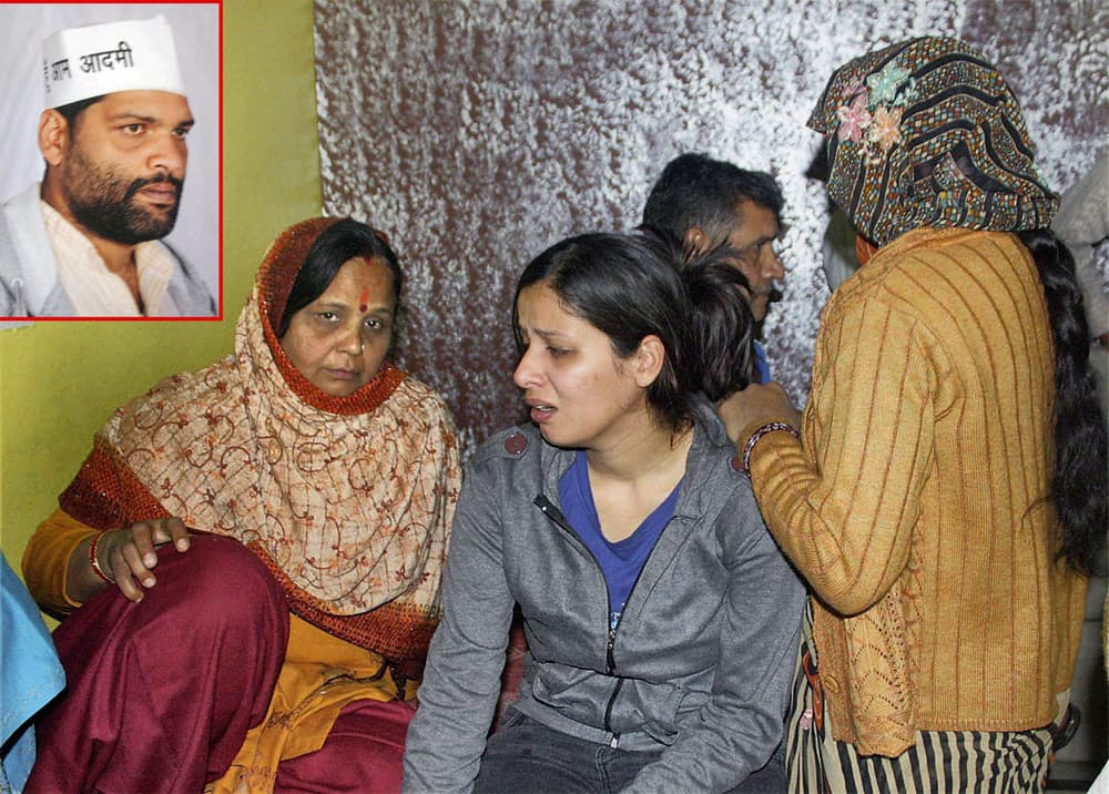 Family members of AAP worker Arvind Malik (inset) who allegedly shot himself with a pistol, mourn his death in east Delhi`s Jaffrabad area.