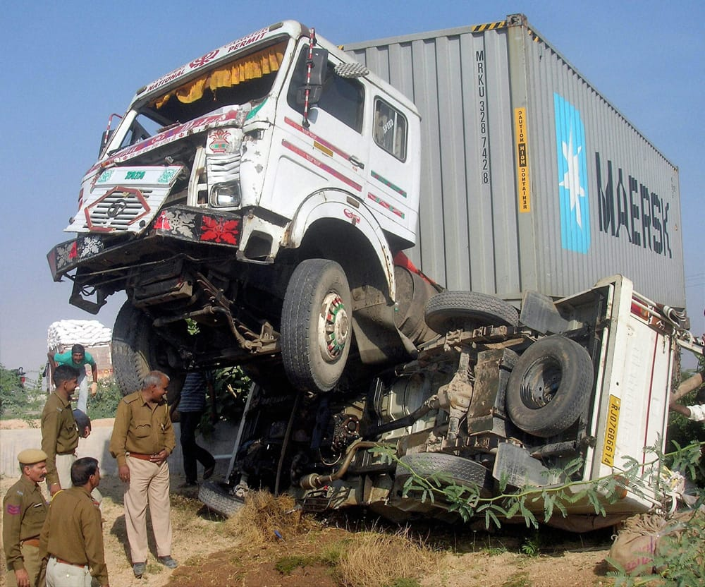 Police men at the accident site after a collision between a truck and a jeep at NH-15 in Bikaner.
