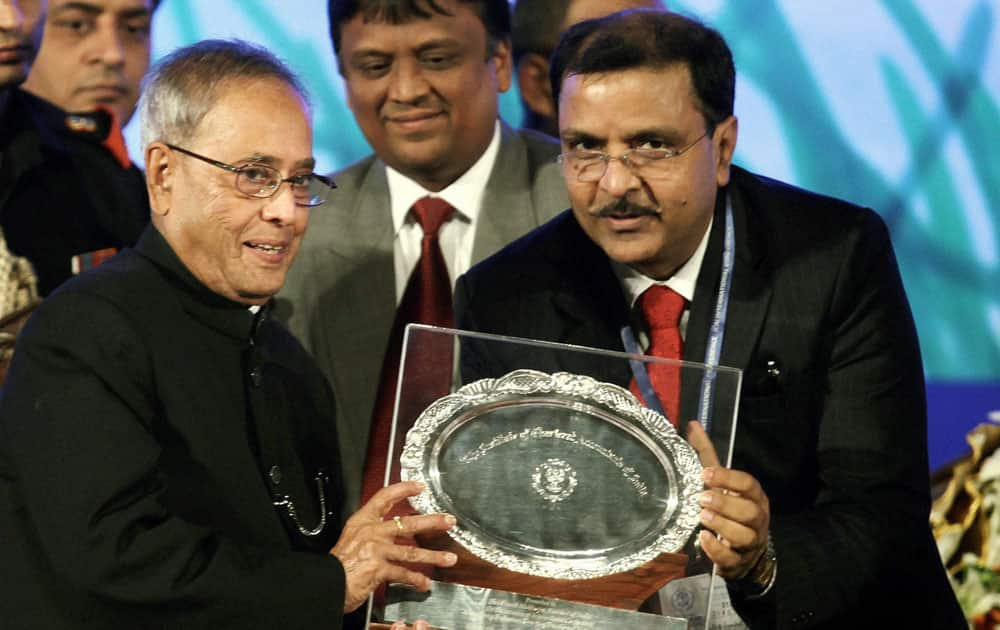 President Pranab Mukherjee receives a memento from Subodh Agarwal,President ICAI during International Conference on `Accountancy Profession-Emerging Frontiers of Future Growth` in Kolkata.