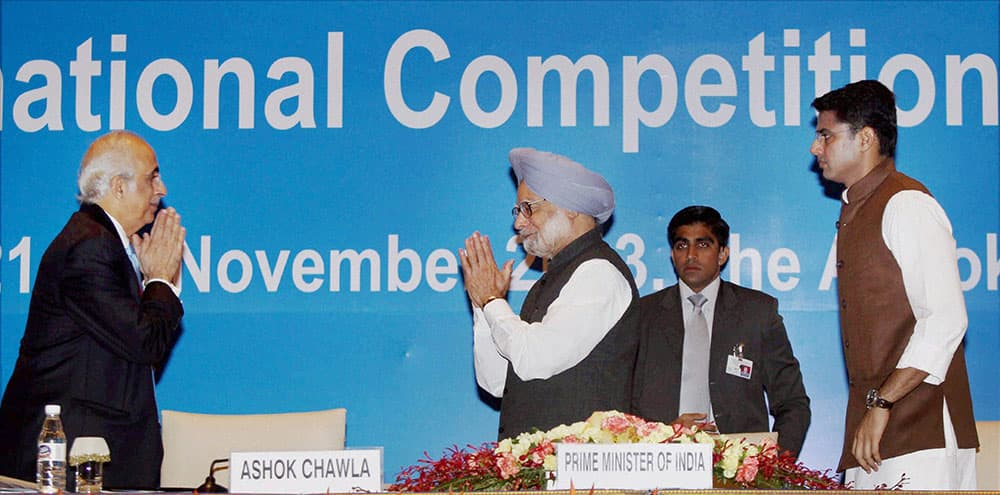 Prime Minister Manmohan Singh being greeted by Competition Commission of India chairman Ashok Chawla as Corporate Affairs Minister Sachin Pilot looks on during the inauguration of 3rd BRICS international Competition Conference in New Delhi.