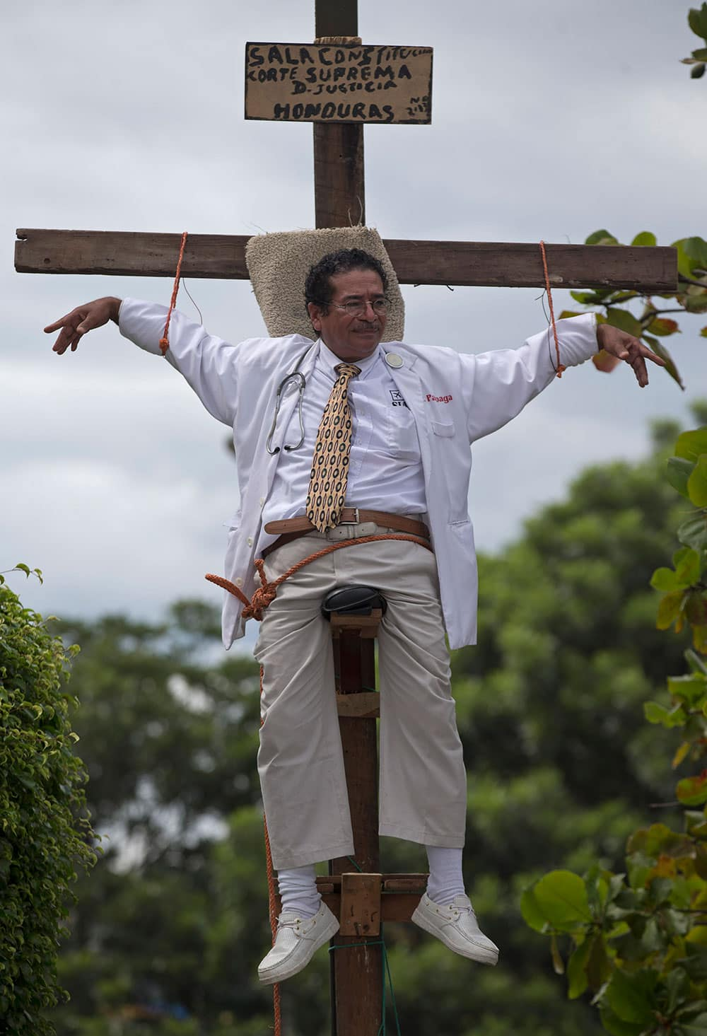 Francisco Pagoada hangs from a cross, with some support, as part of his protest against the Supreme Court that denied Pagoada`s request to run as an independent candidate for mayor, in Tegucigalpa, Honduras.
